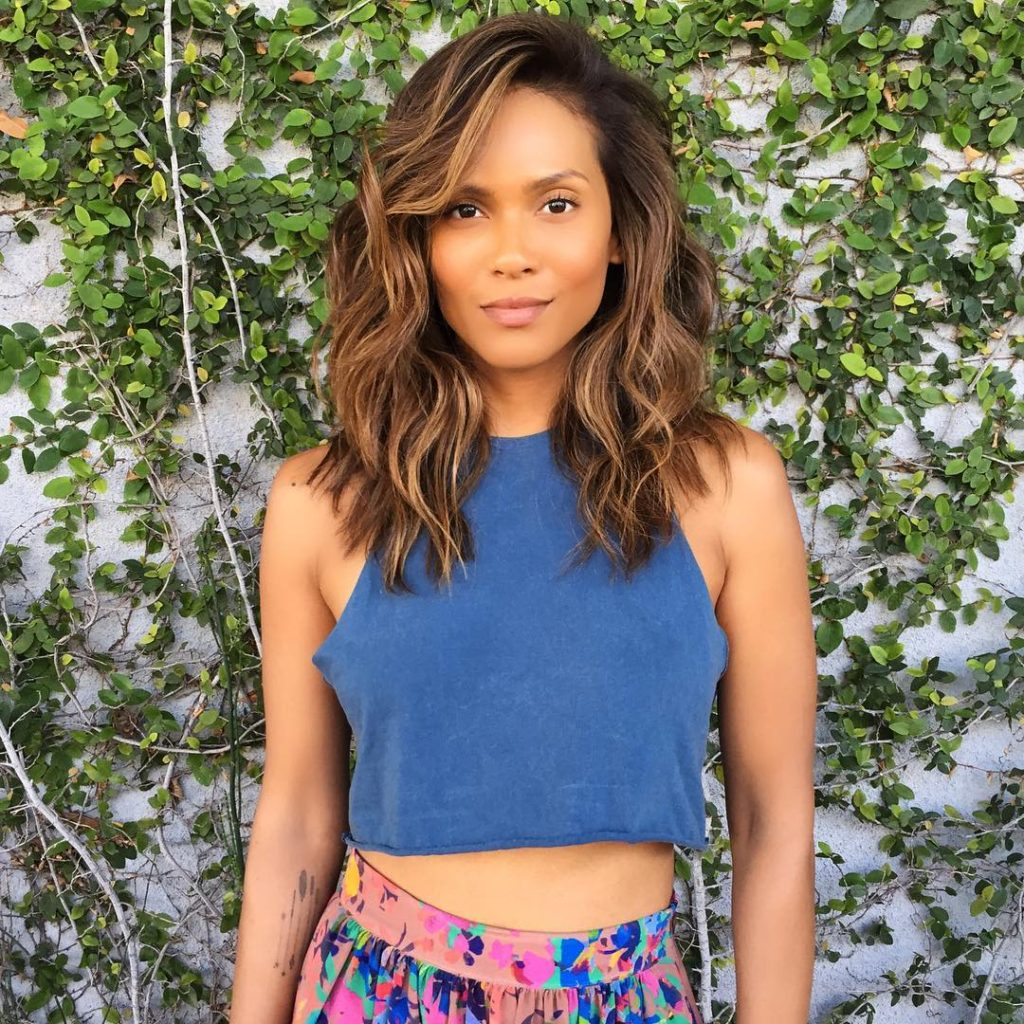 Angled Wavy Layered Lob with Long Side Swept Bangs and Sun Kissed Brunette Balayage Medium Length Summer Hairstyle