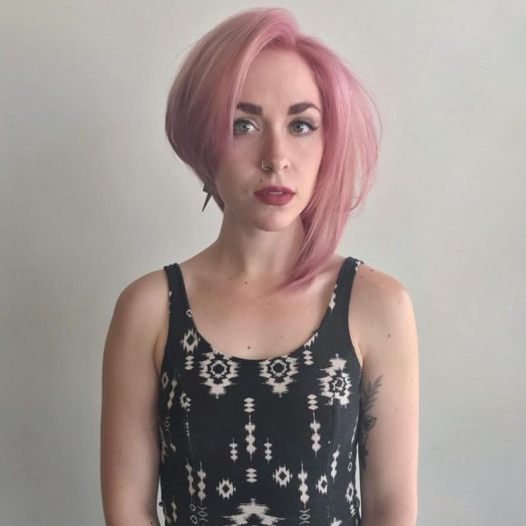 Asymmetric Blowout Bob with Messy Straight Texture and Pink Pastel Hair Color Short Hairstyle