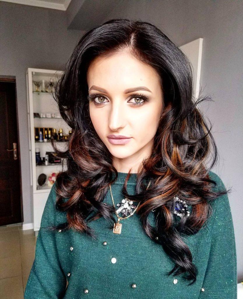 Beautiful Dark Layered Cut with Voluminous Wavy Texture and Caramel Highlights Long Hairstyle
