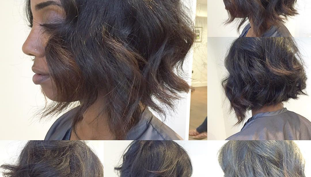 Black Angled Bob with Textured Waves and Brunette Highlights Short Hairstyle