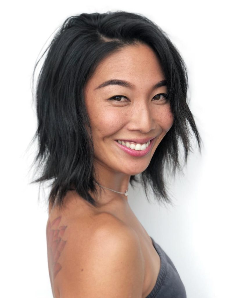 Black Bob with Seamless Layers and Undone Texture Medium Length Hairstyle