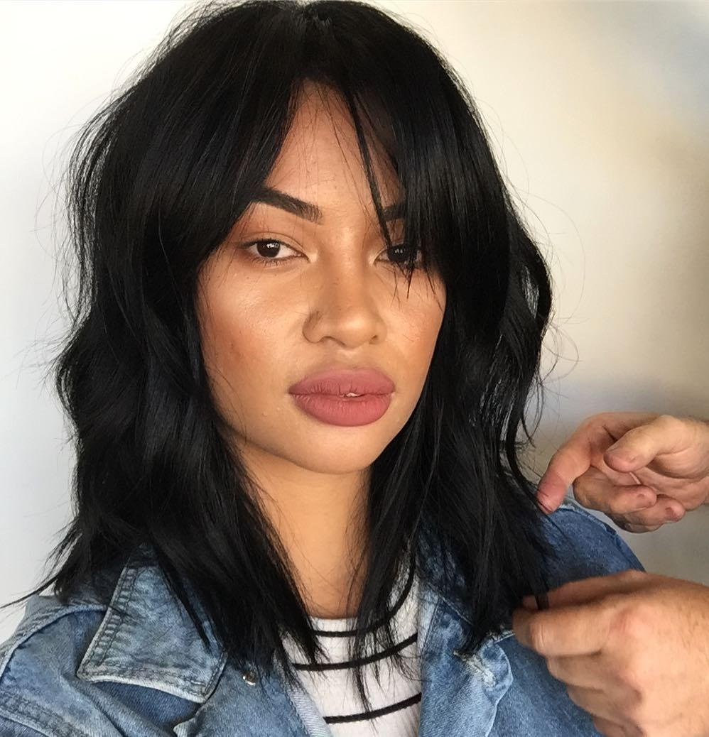 Black Layered Lob with Messy Wavy Texture and Long Fringe Bangs Medium Length Summer Hairstyle