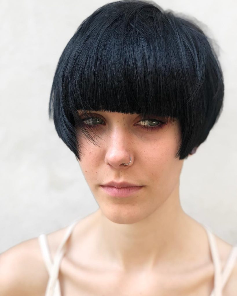 Black Modern Geometric Pixie with Full Blunt Bangs and Bevelled Straight Texture Short Chic Retro Hairstyle
