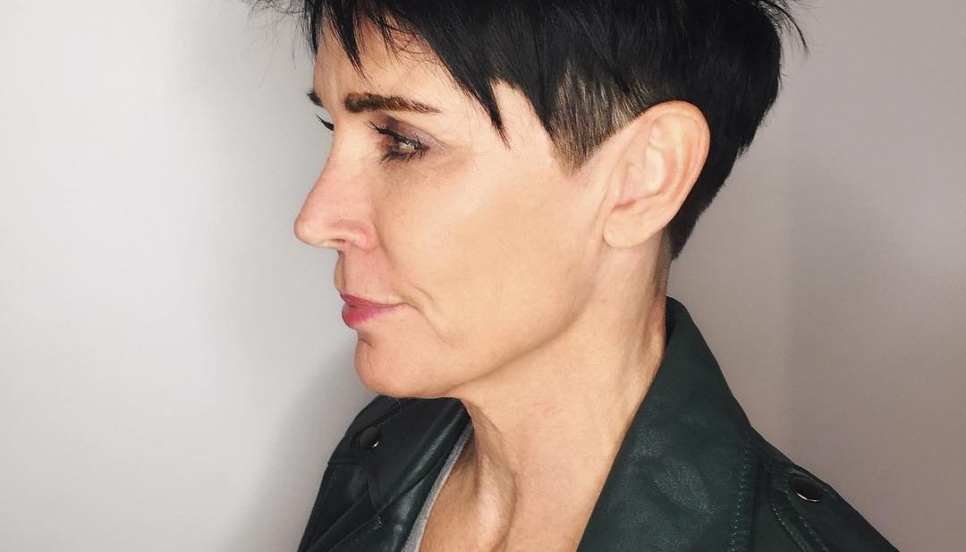 Black Razor Cut Pixie with Spiky Texture and Clean Lines Short Hairstyle