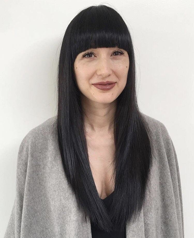 Black Retro Inspired Razor Cut with Full Blunt Arched Bangs and Straight Texture Long Fall Hairstyle