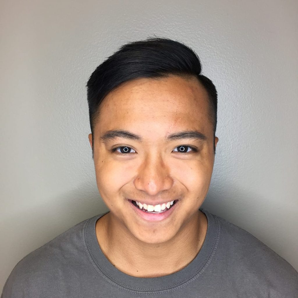 Black Textured Side Part with Taper and Fade