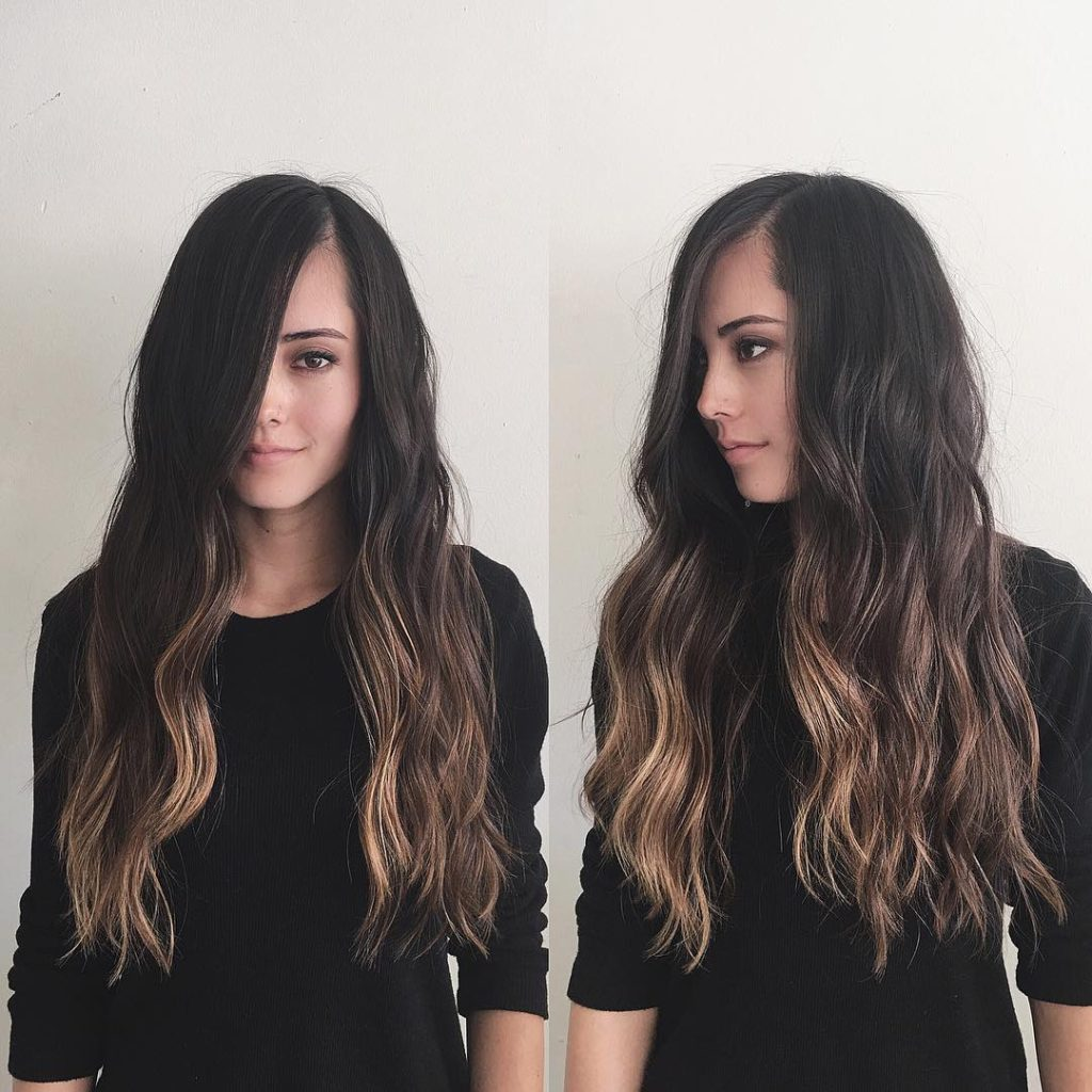 Blended Side Swept Layered Cut with Wavy Texture and Brunette Color Melt Ombre Long Hairstyle