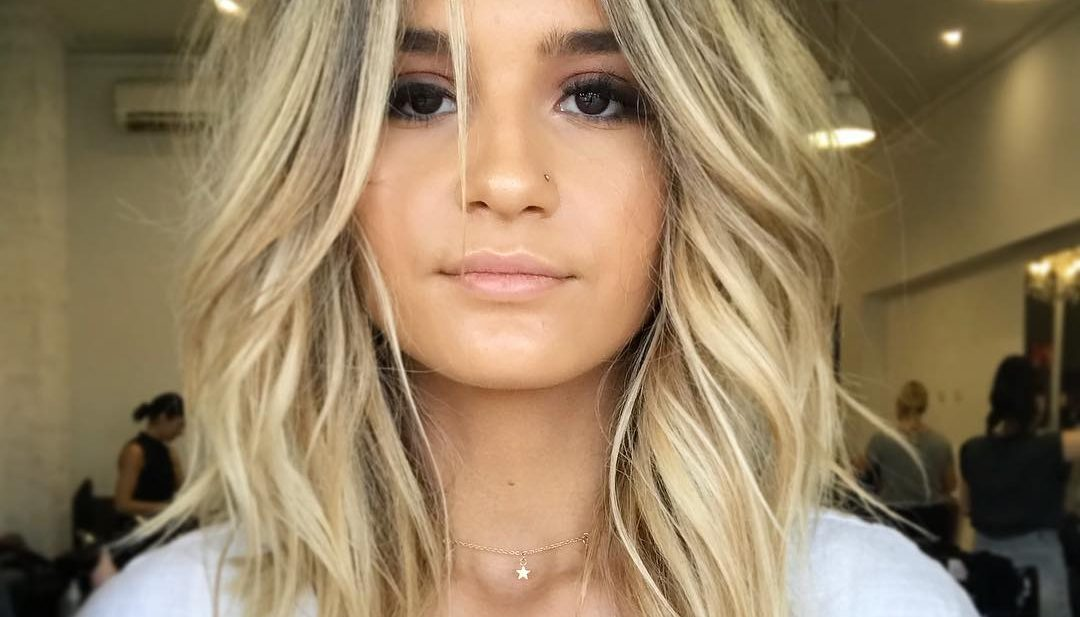 Blonde Curtain Banged Lob with Soft Undone Textured Waves and Dark Ash Shadow Roots Medium Length Hairstyle