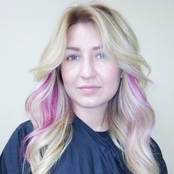 Blonde Curtained Layered Cut with Bombshell Wavy Texture and Magenta Pink Peek-a-Boo Highlights Long Fall Hairstyle