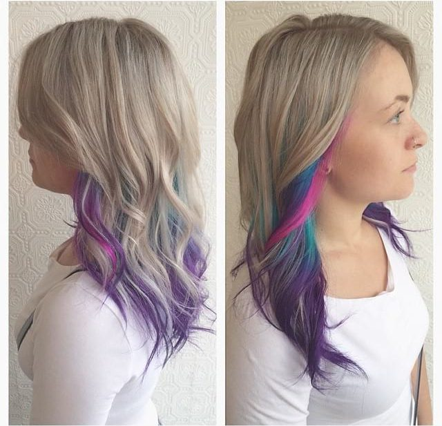 Blonde Layered Cut with Tousled Waves and Rainbow Highlights Long Hairstyle