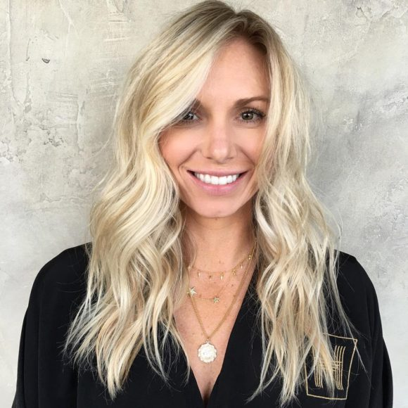 Blonde Layered Cut with Tousled Waves and Subtle Balayage Highlights Long Hairstyle