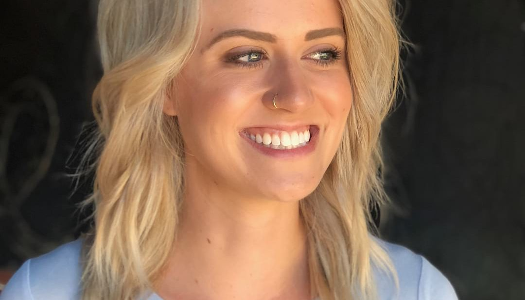 Blonde Long Layered Lob with Side Swept Bangs and Messy Wavy Texture Medium Length Summer Hairstyle
