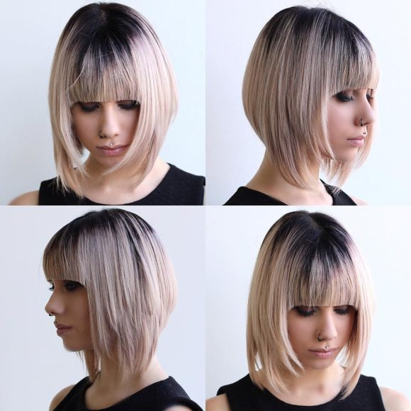 Blonde Razor Cut Angled Bob with Full Blunt Bangs and Black Shadow Roots Medium Length Hairstyle