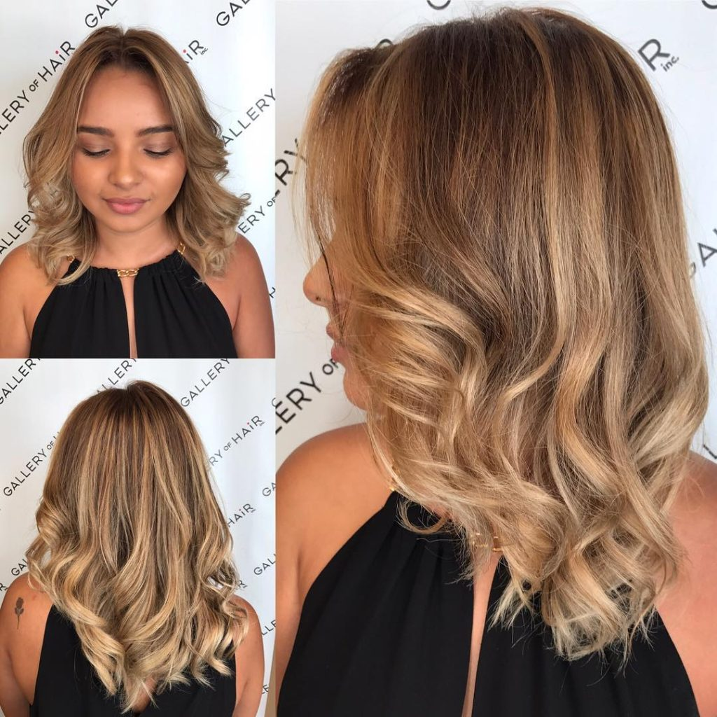 Blonde Sun Kissed Layered Cut with Large Soft Waves and Parted Face Framing Layers Medium Length Hairstyle