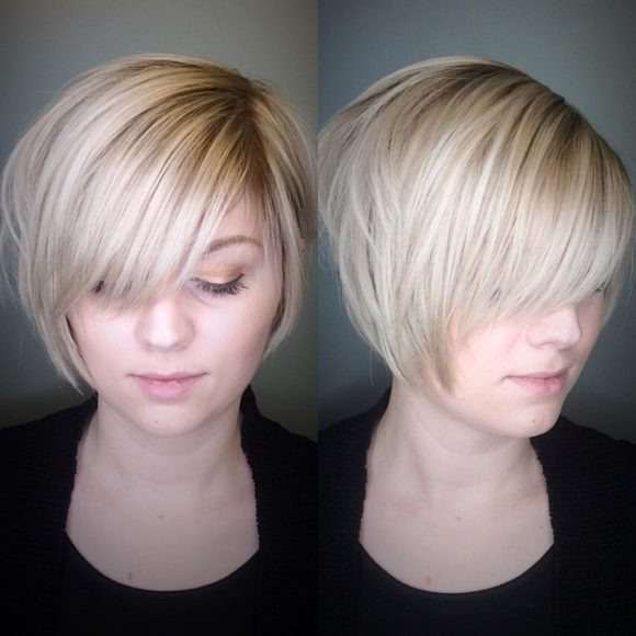 Polished Blonde Stacked Bob with Side Swept Bangs and Soft Highlights Short Hairstyle