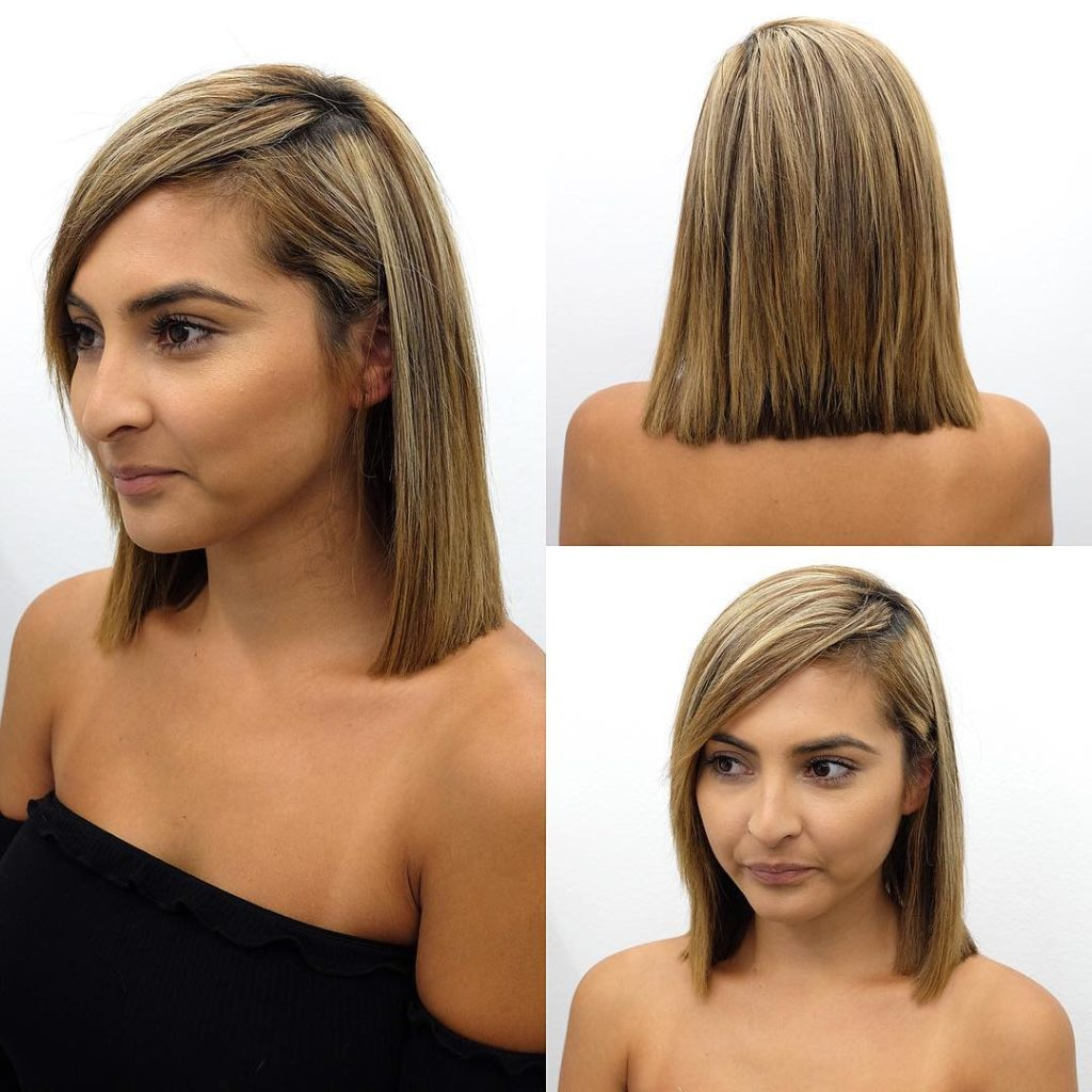Blunt Shoulder Length Bob with Side Swept Bangs and Highlights Medium Length Hairstyle