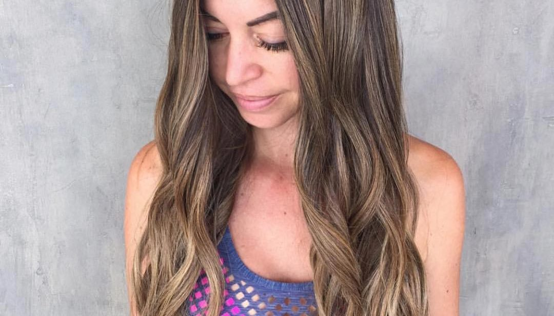 Boho Chic Layered Hair with Wavy Beach Texture and Sun Kissed Bronde Balayage Long Summer Hairstyle