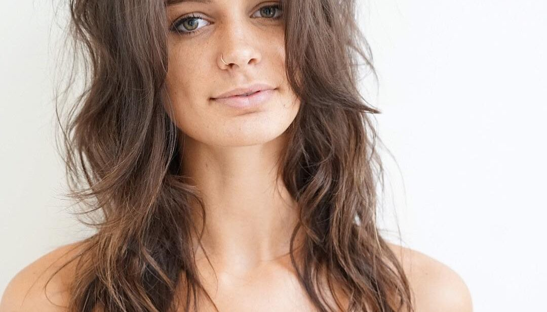 Boho Chic Shag with Long Curtain Bangs and Messy Beach Wavy Texture on Brown Hair Long Summer Hairstyle