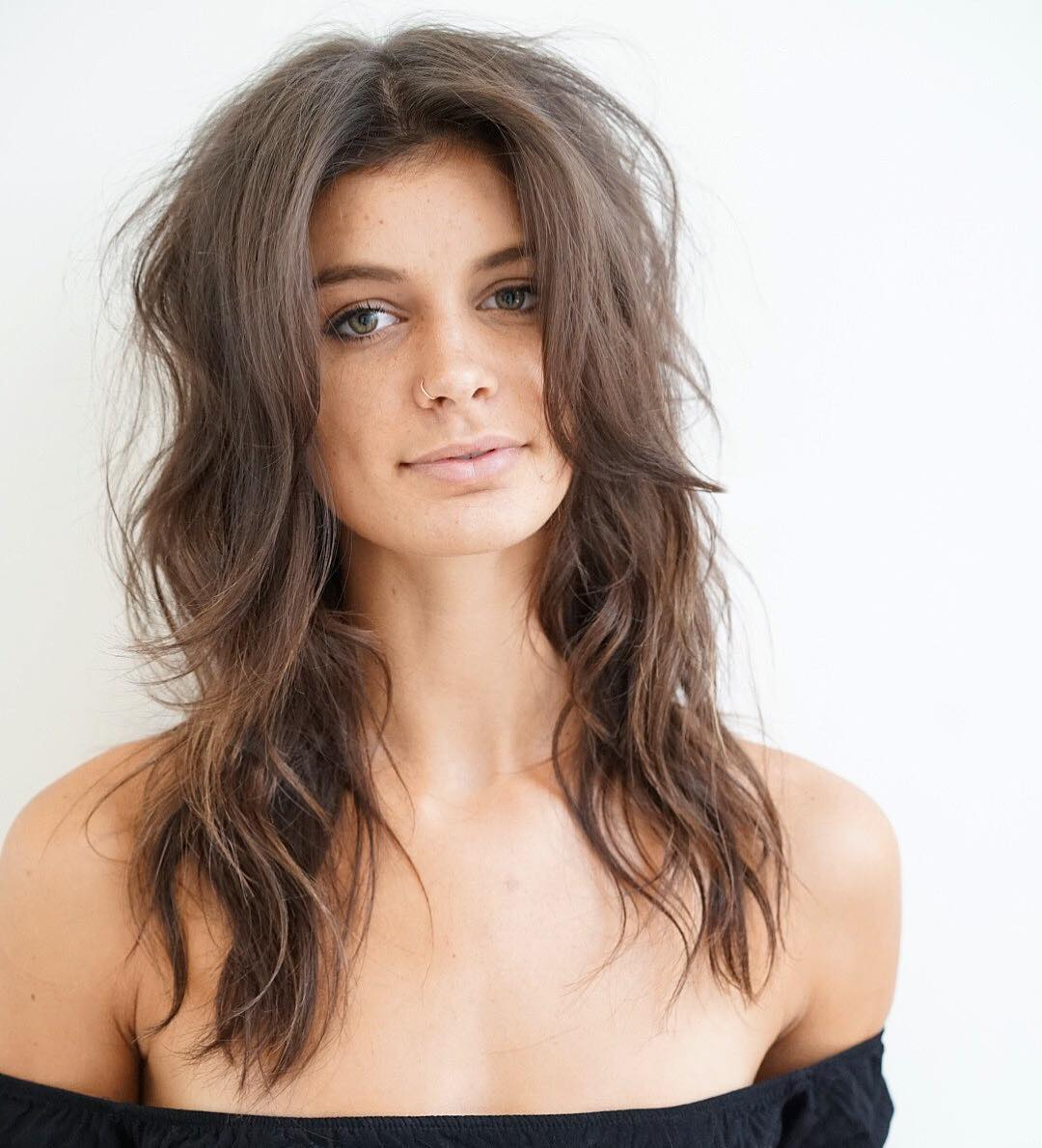 Boho Chic Shag With Long Curtain Bangs And Messy Beach Wavy Texture On Brown Hair The Latest Hairstyles For Men And Women 2020 Hairstyleology