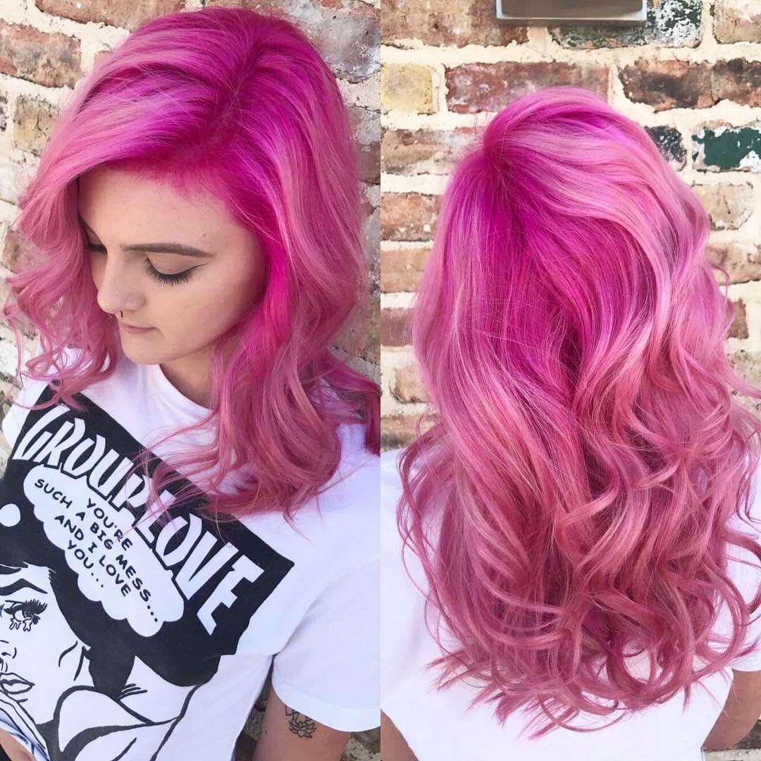 Bright Pink Layered Cut with Waterfall Waves and Soft Pink Highlights Long Hairstyle