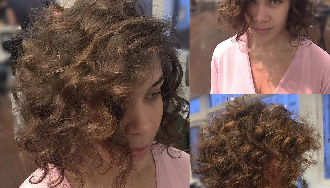Brunette Angled Bob with Large Soft Curls and Side Part Short Hairstyle