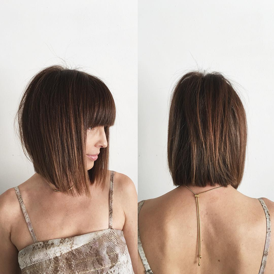 Brunette Bob with Full Blunt Bangs and Undone Straight Texture Medium Length Hairstyle