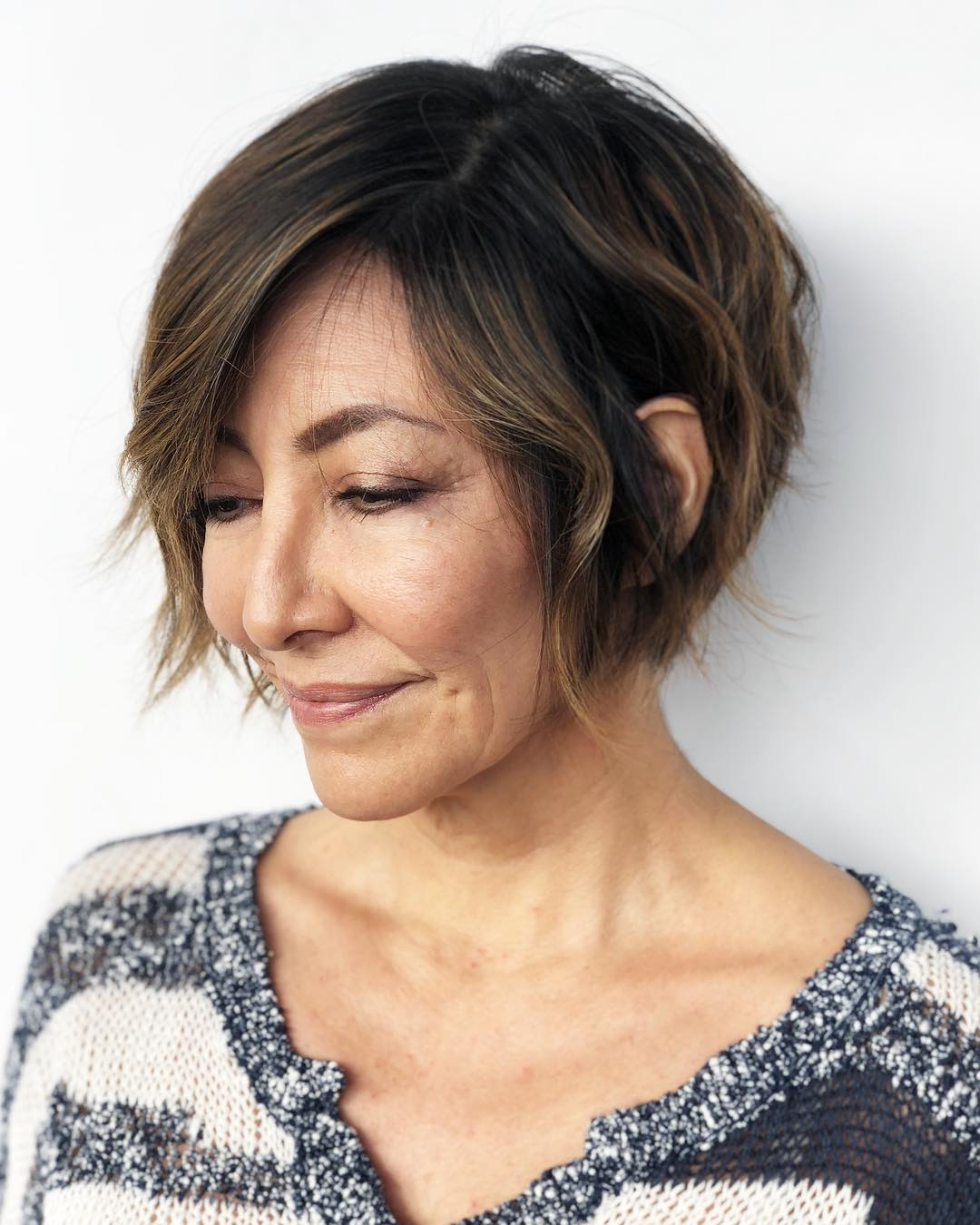 Brunette Cropped Bob with Undone Texture and Side Swept Bangs Short Hairstyle