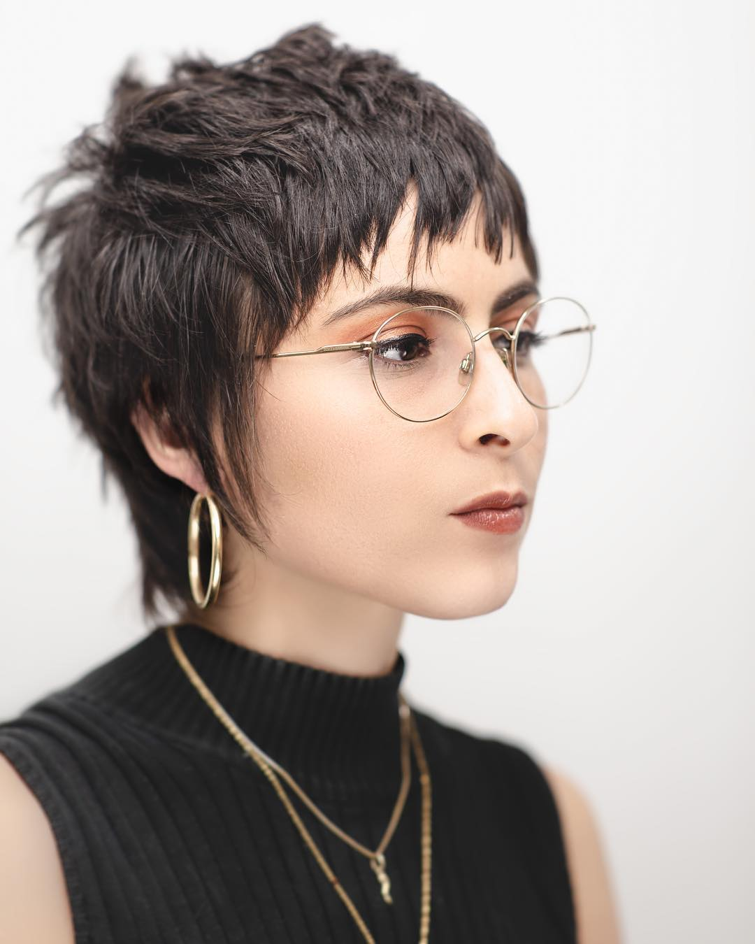 Brunette Cropped Razor Cut Mullet with Messy Texture and Choppy Fringe with Sideburns Short Fall Hairstyle