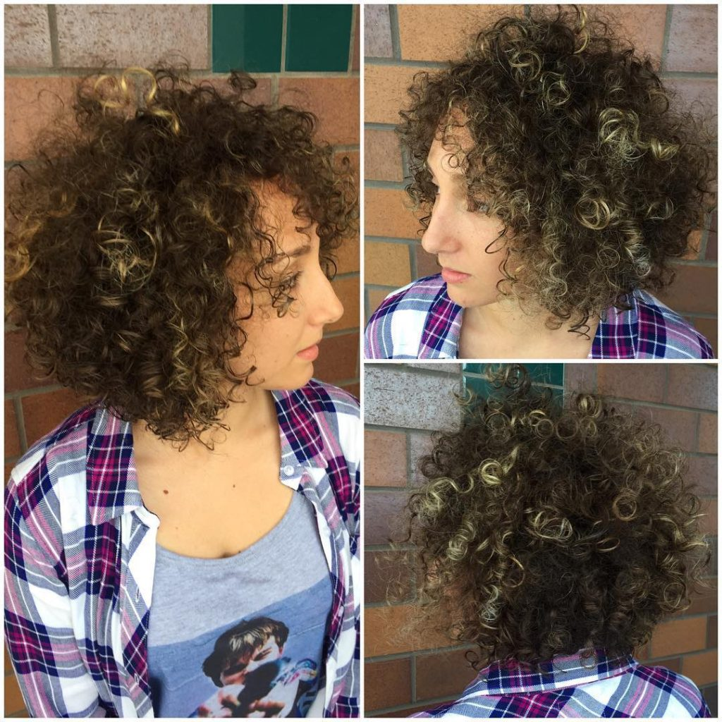 Brunette Layered Bob with Bouncy Corkscrew Curls and Blonde Highlights Medium Length Hairstyle