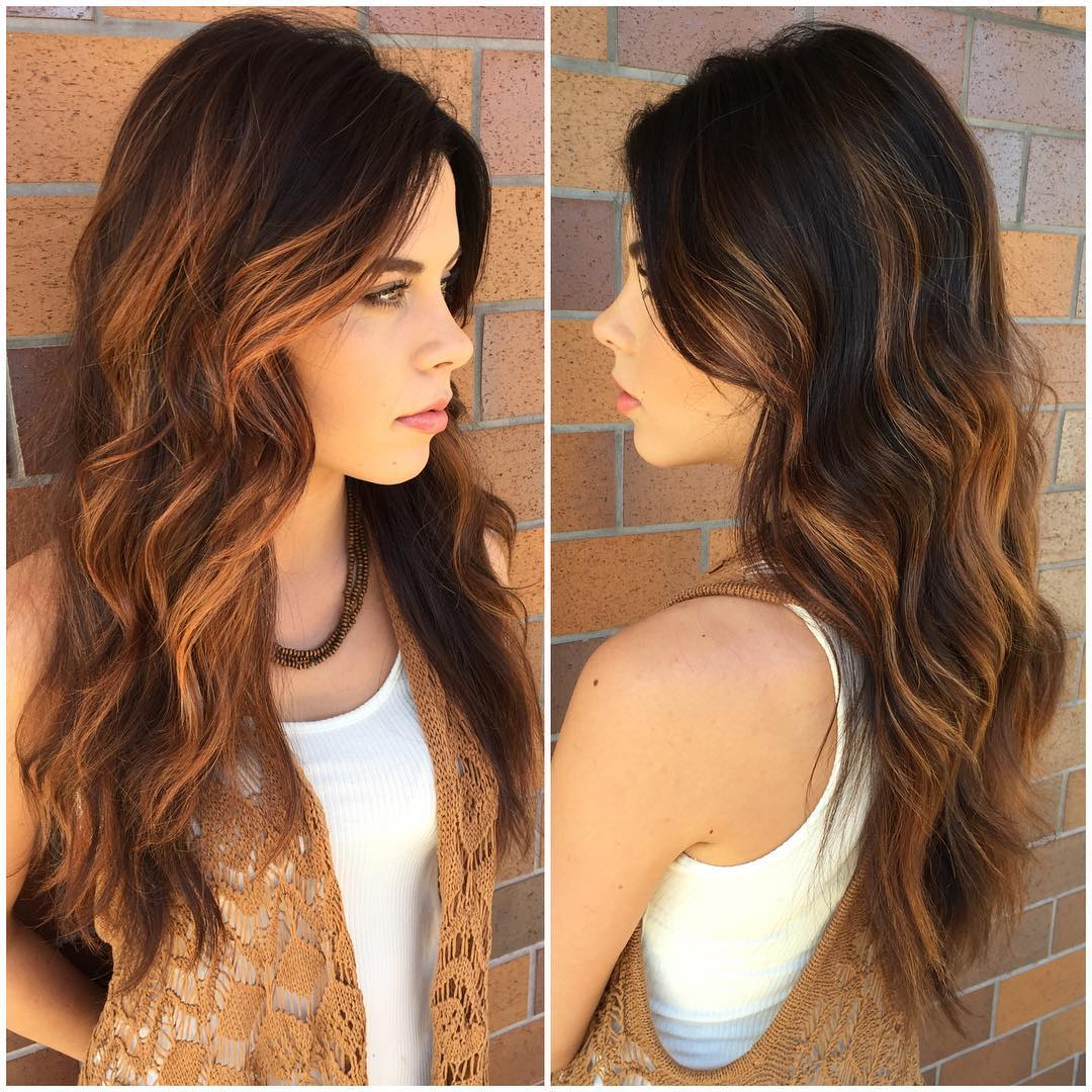 Brunette Layered Cut with Tousled Waves and Warm Caramel Highlights Long Hairstyle
