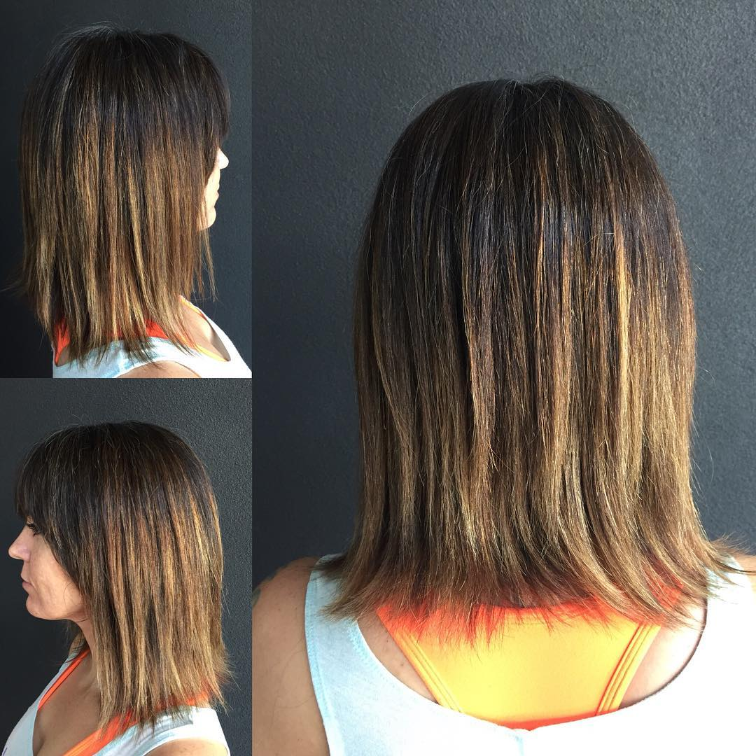 Textured Razor Cut Bob with Brow Skimming Bangs andBrunetteOmbre Coloring Medium Length Hairstyle