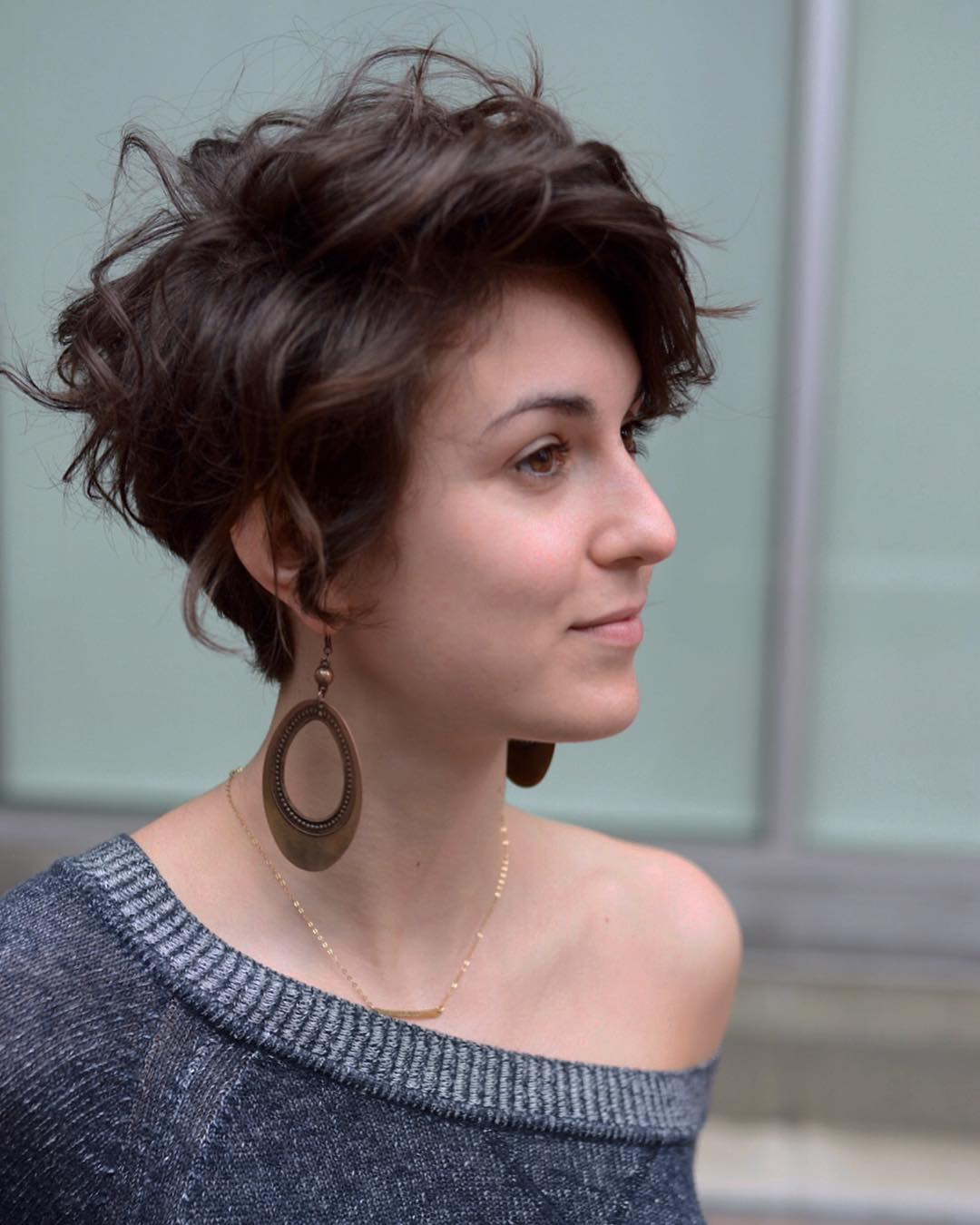 Chic Brunette Scissor Cut Pixie with Long Side Swept Bangs and Messy Wavy Texture Short Modern Feminine Hairstyle