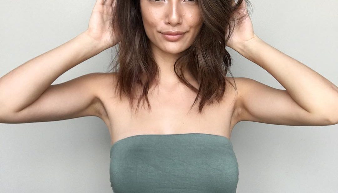 Brunette Seamless Layered Lob with Tousled Soft Waves and Subtle Highlights Medium Length Hairstyle