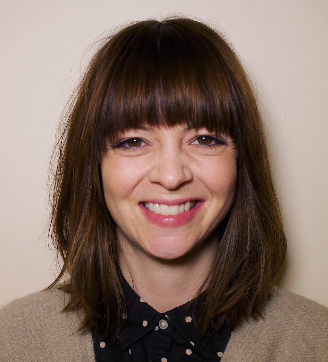 Brunette Textured Lob with Seamless Layers and Fringe Bangs Medium Length Hairstyle