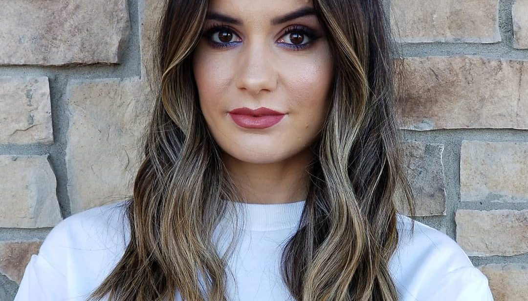 Center Parted Past the Shoulders Layered Cut with Wavy Texture and Dark Brunette to Blonde Color Melt Balayage Medium Length Summer Hairstyle