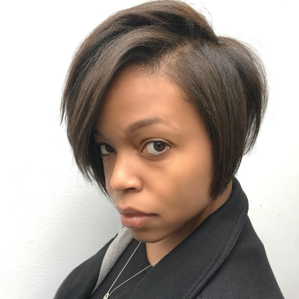 Chic Brunette Modern Bob with Side Swept Bangs and Subtle Graduation Short Fall Hairstyle