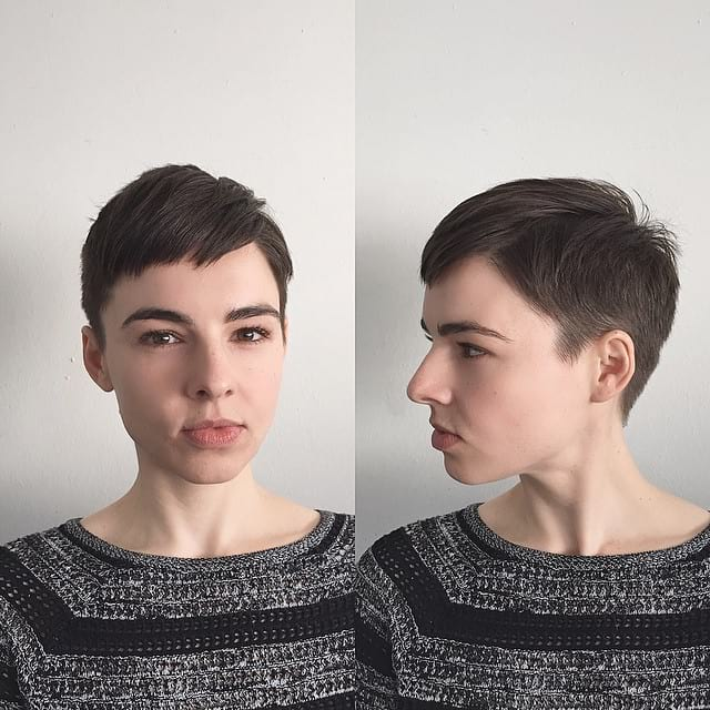Chic Brunette Textured Pixie with Side Swept Baby Bangs and Taper Short Hairstyle