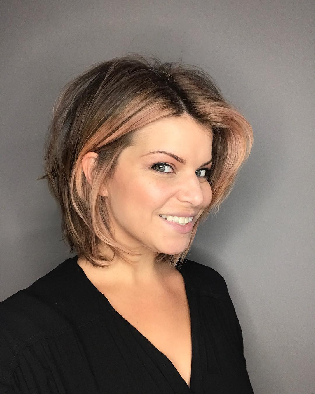 Chic Dark Blonde Layered Bob with Undone Blowout Texture and Rose Gold Balayage Highlights Medium Length Hairstyle