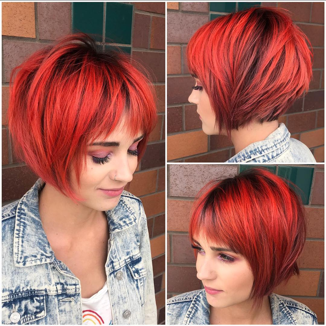 Choppy Red Graduated Bob with Fringe Bangs and Black Shadow Roots Short Hairstyle