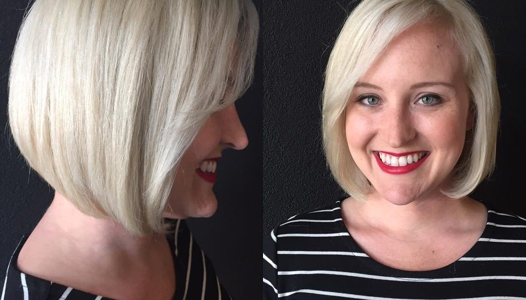 Classic Platinum Bob with Side Swept Bangs Medium Length Hairstyle