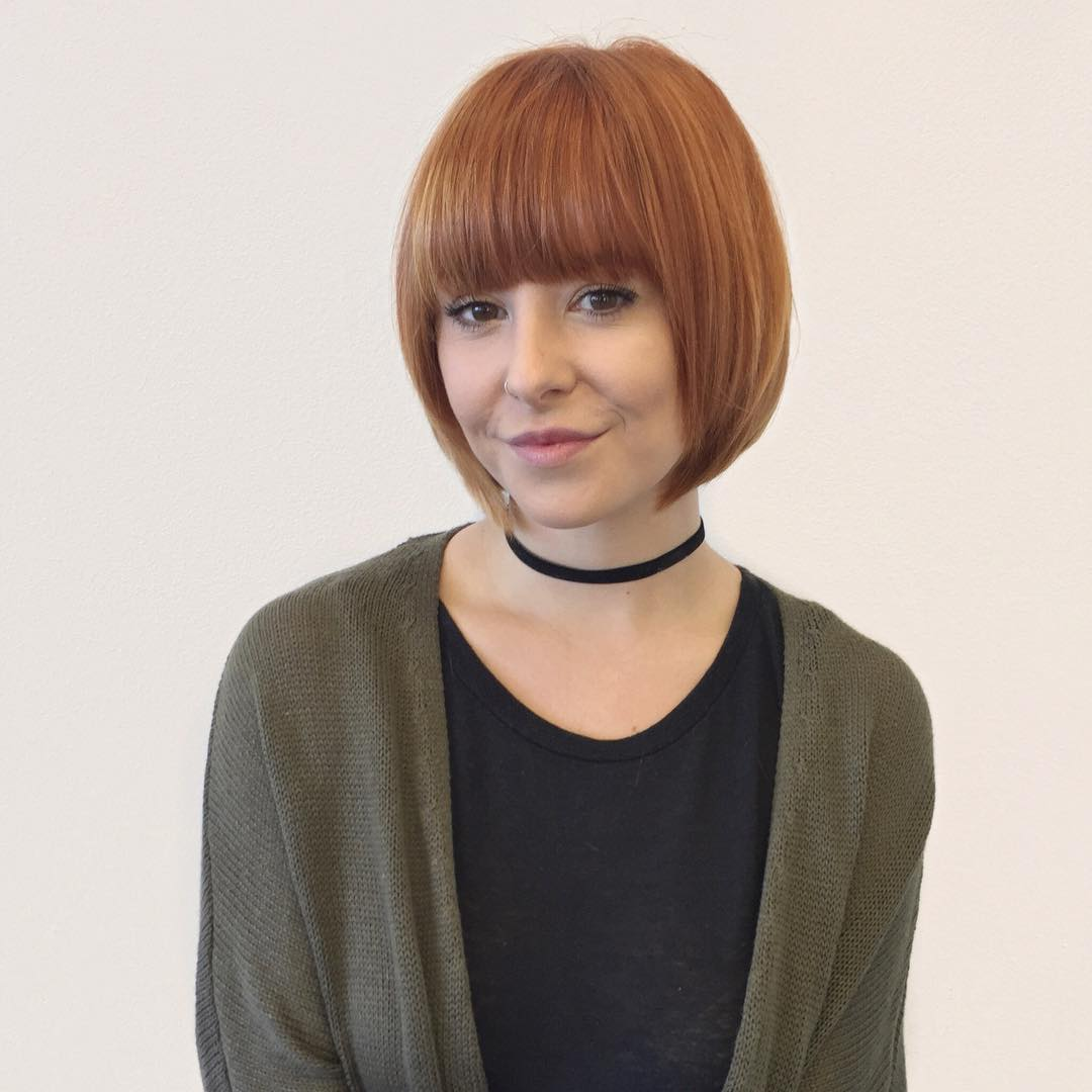 Classic Red Bob with Brow Skimming Bangs Short Hairstyle