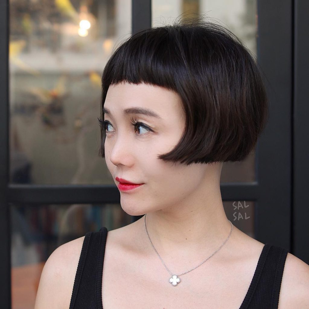 Contoured Retro Bob with Micro Bangs and Blunt Lines with Textured Ends Short Hairstyle