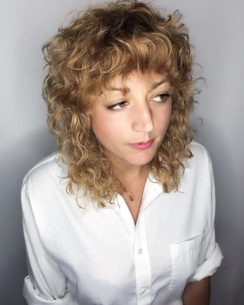 Curly Layered Fringe Cut with Bangs and Dark Blonde Color Medium Length Hairstyle