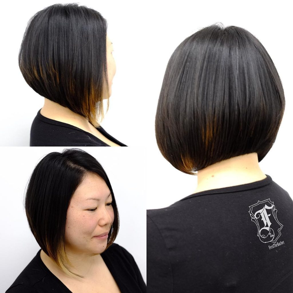 Dark Angled Bob with Stacked Layers and Peek-a-Boo Highlights Medium Length Hairstyle