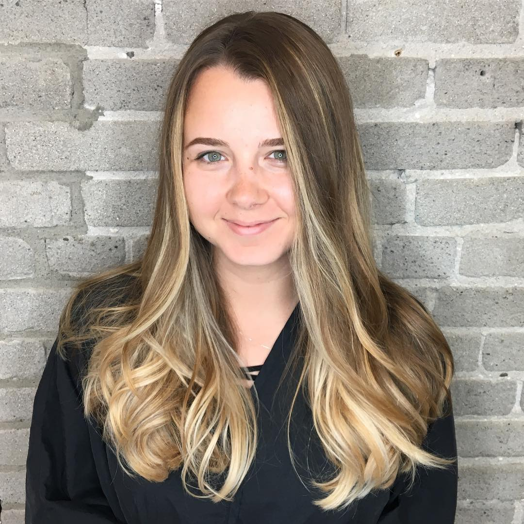Dark Blonde Blowout with Seamless Layers and Sun Kissed Balayage Highlights Long Hairstyle