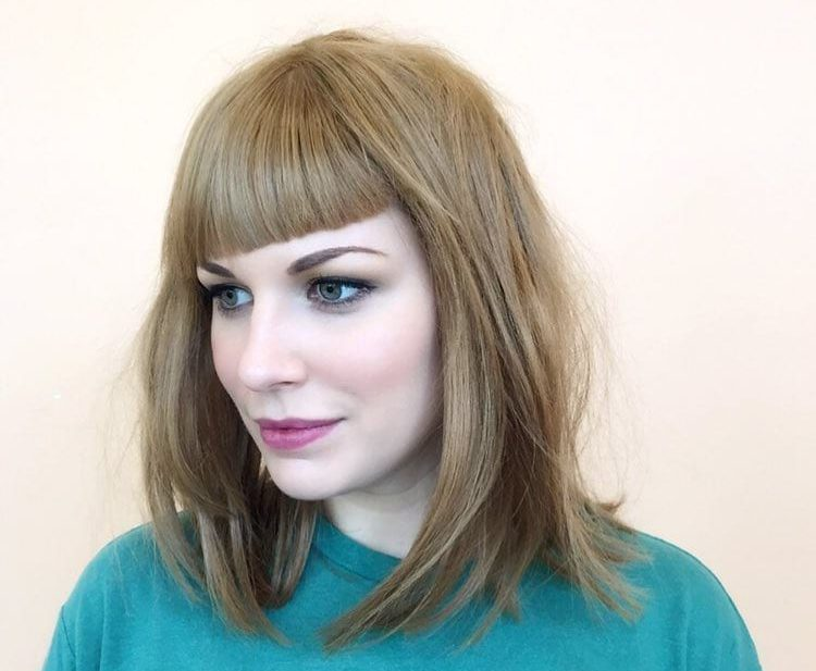 Dark Blonde Layered Lob with Blunt Shaped Bangs and Undone Straight Texture Medium Length Hairstyle