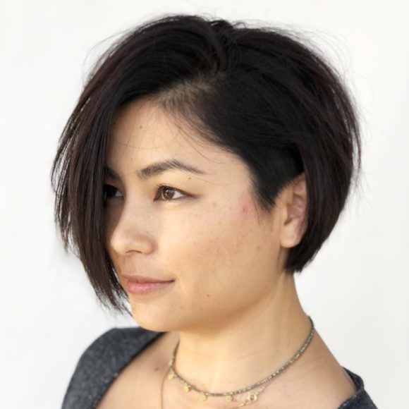 Dark Brunette Asymmetric Bob with Undercut Sides and Side Swept Bangs Short Fall Hairstyle