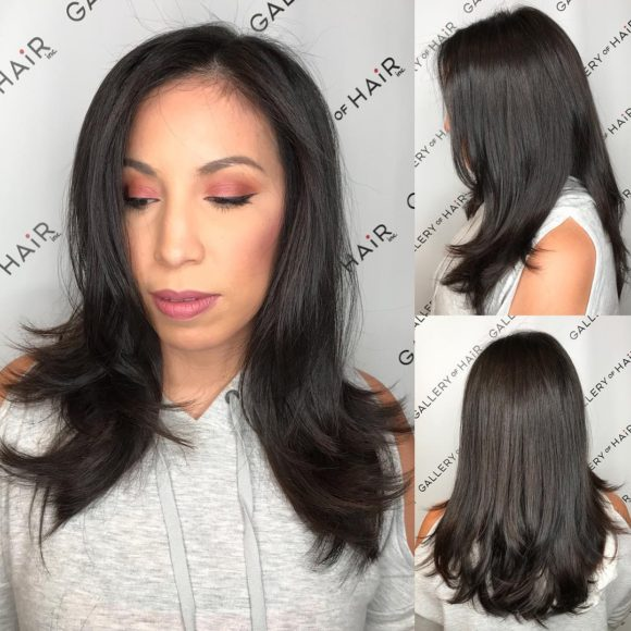 Dark Brunette Layered Cut with Soft Blowout Waves and Face Framing Layers Long Hairstyle