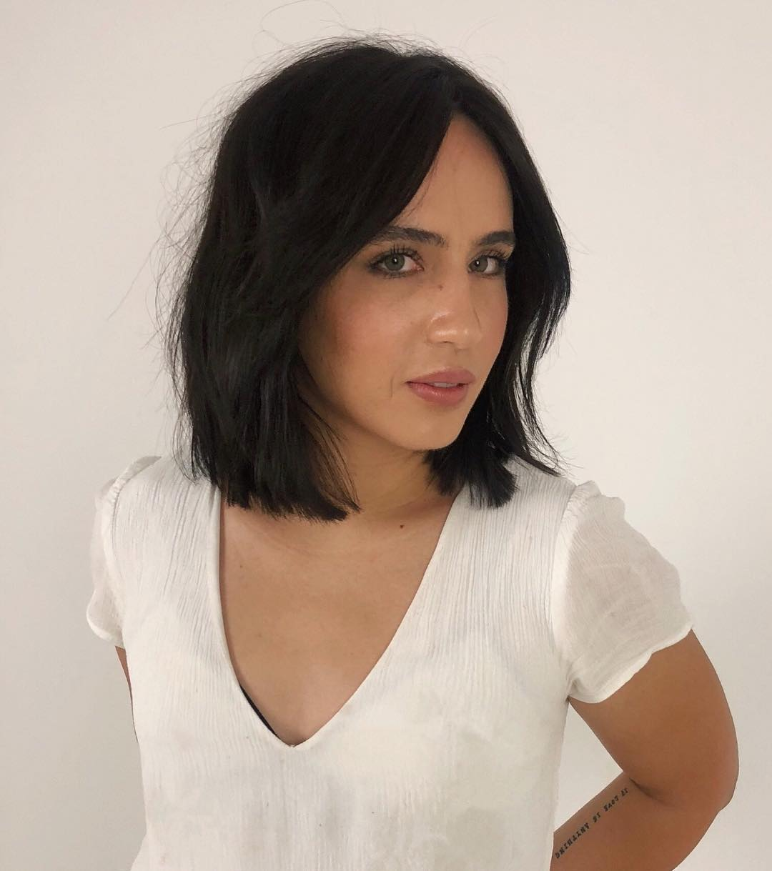 Dark Brunette One Length Lob with Long Curtain Bangs and Textured Ends Medium Length Fall Hairstyle