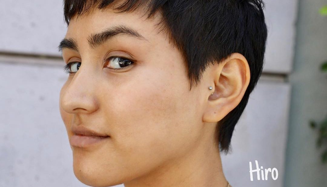Dark Brunette Textured Pixie with Baby Bangs and Sideburns Short Summer Hairstyle